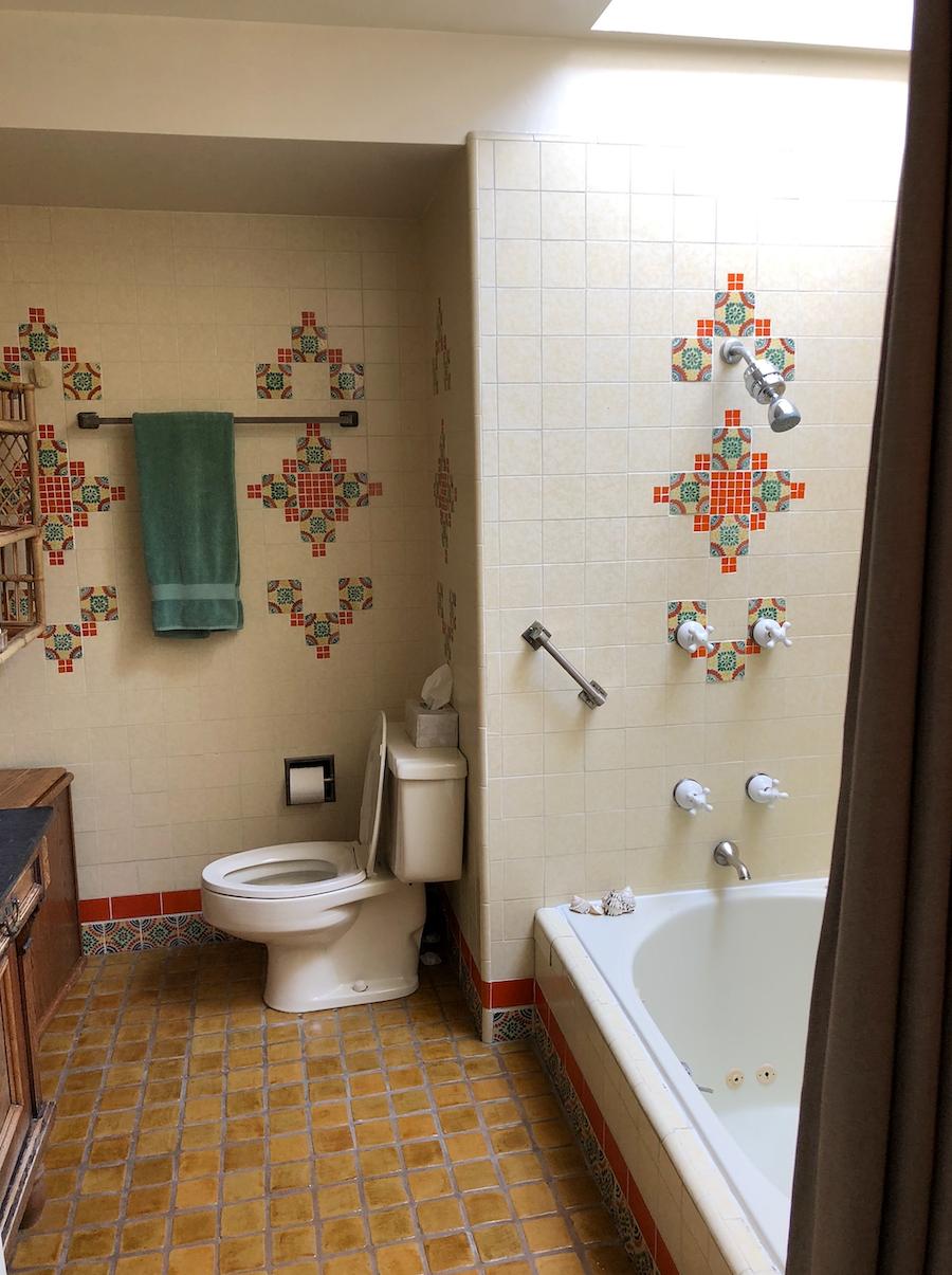 old bathroom with orange tiles