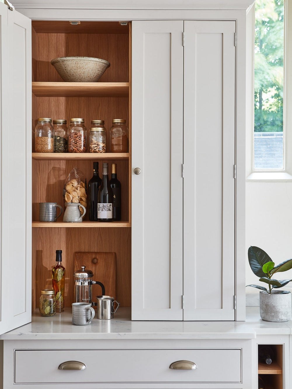 grey kitchen cabinet with organized pantry staples