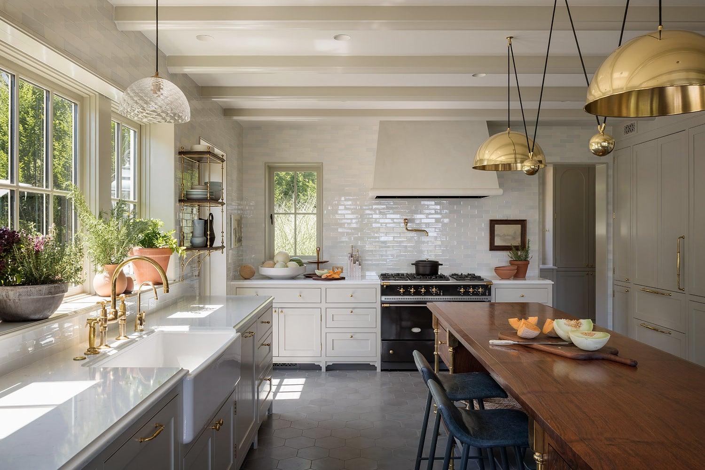 farmhouse kitchen with large brass pendants