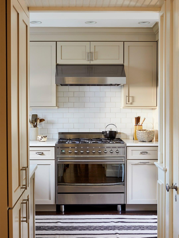 cream white kitchen with black and white rug