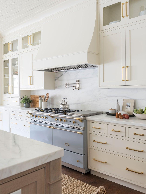 blue stove in a white kitchen