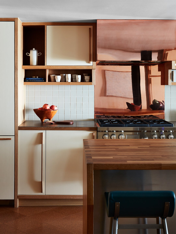 cooper backsplahs in a white and wood kitchen