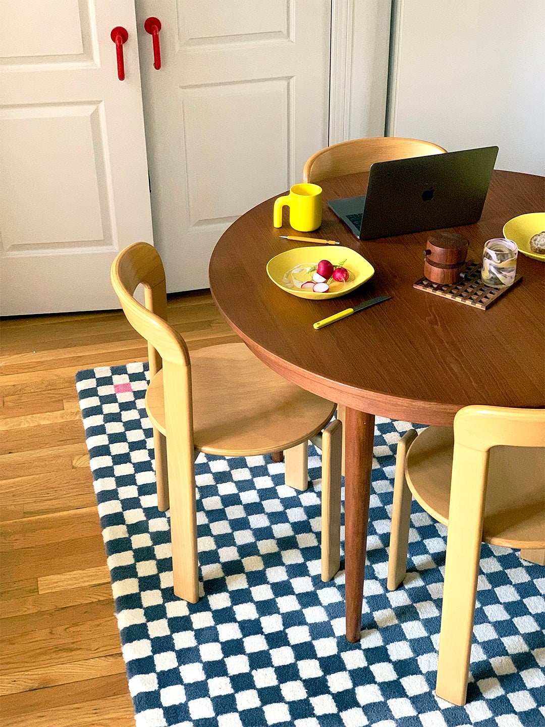 dining room table and chairs with grid rug