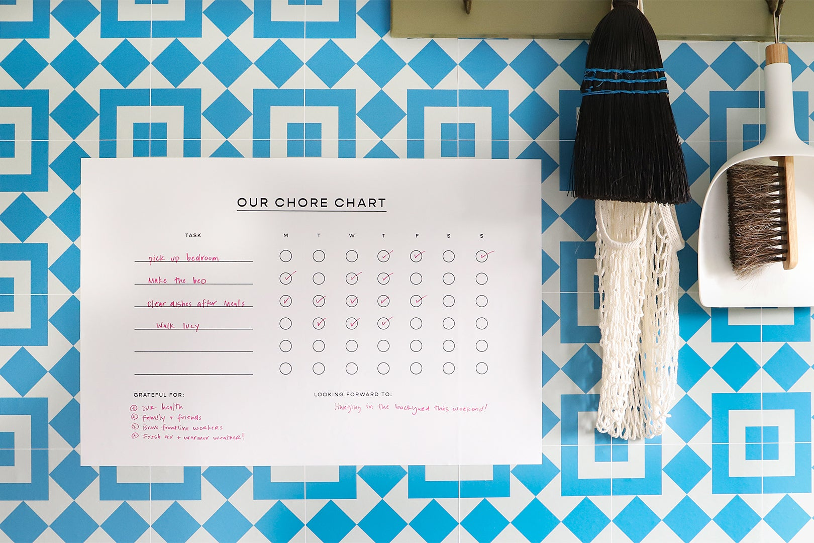 blue tile wall wiht chore chart