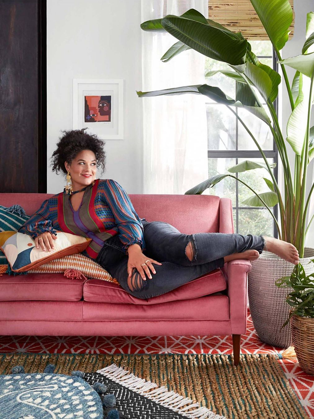 Justina Blakeney sitting on pink couch