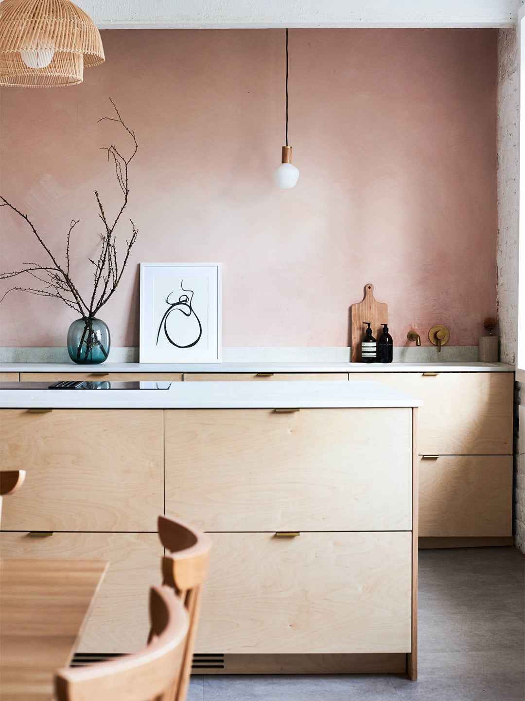 pink kitchen with natural wood cabinets