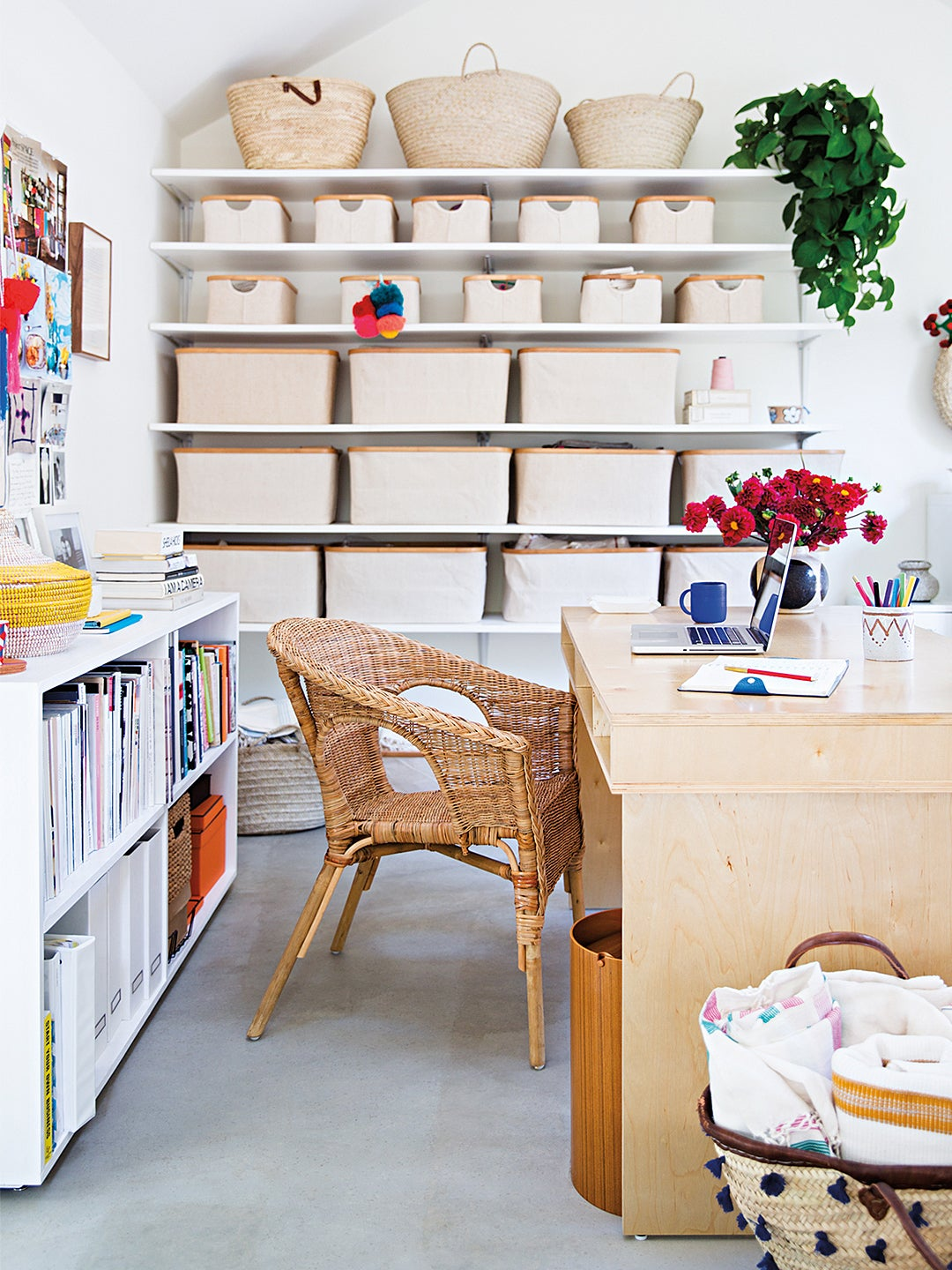 workspace with wooden desk and craft shelves