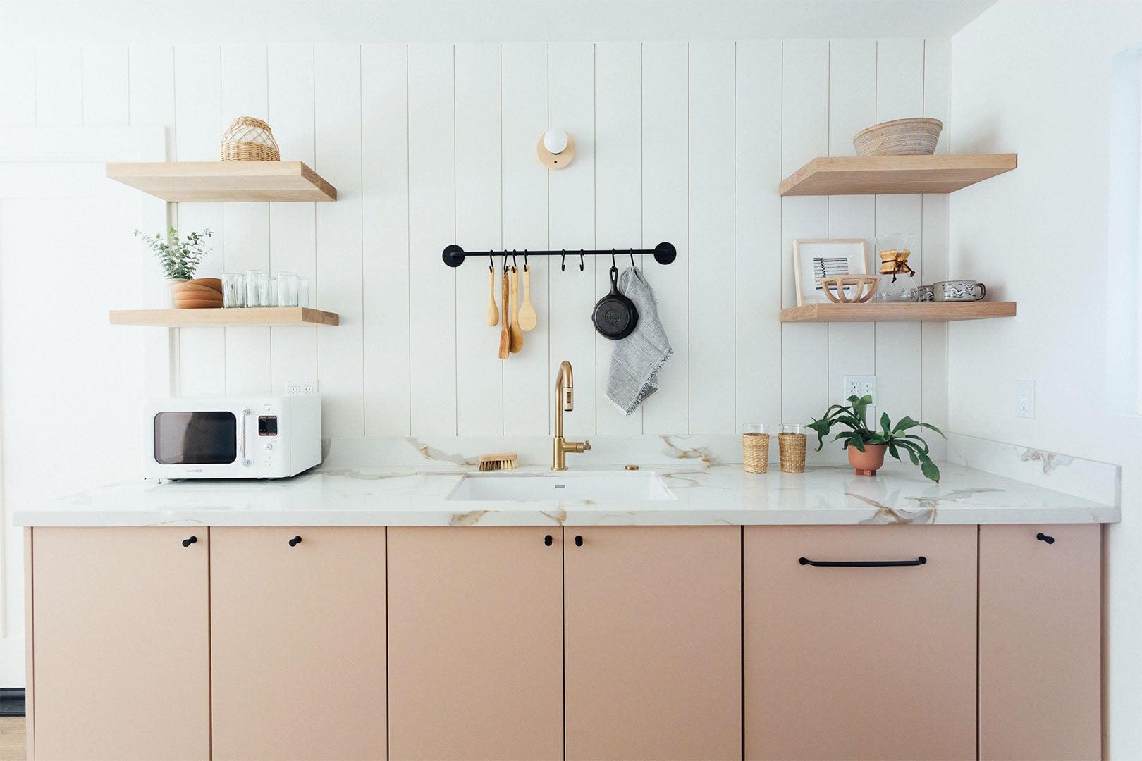 natural wood cabinets and shiplap backsplash