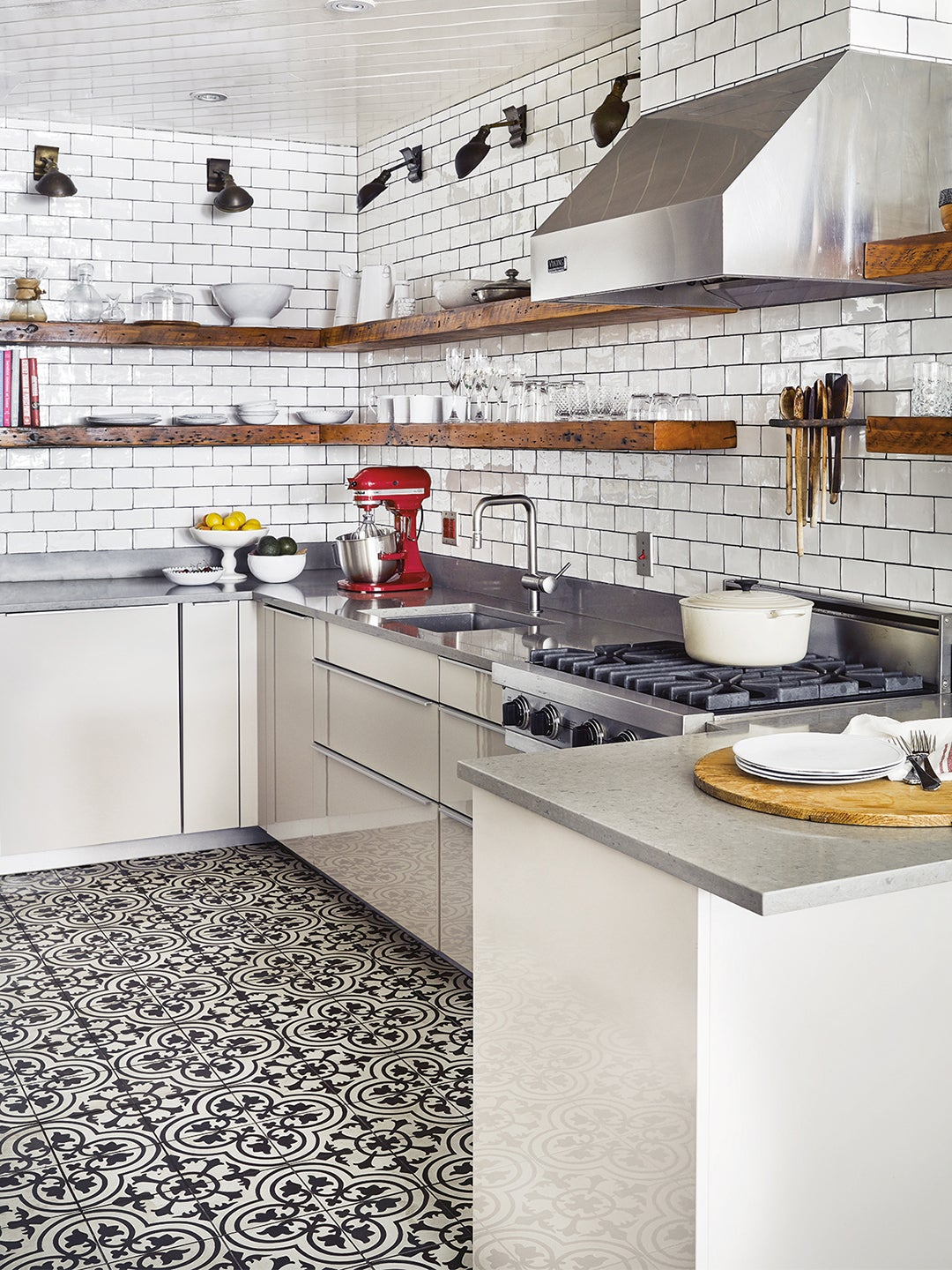 white kitchen with black and white tiles, open shelving