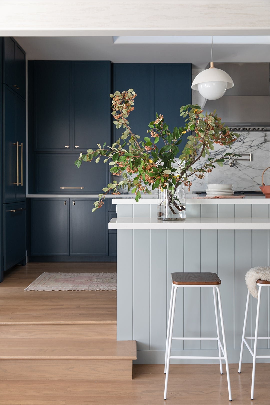 Kitchen with two-tone blue cabinets