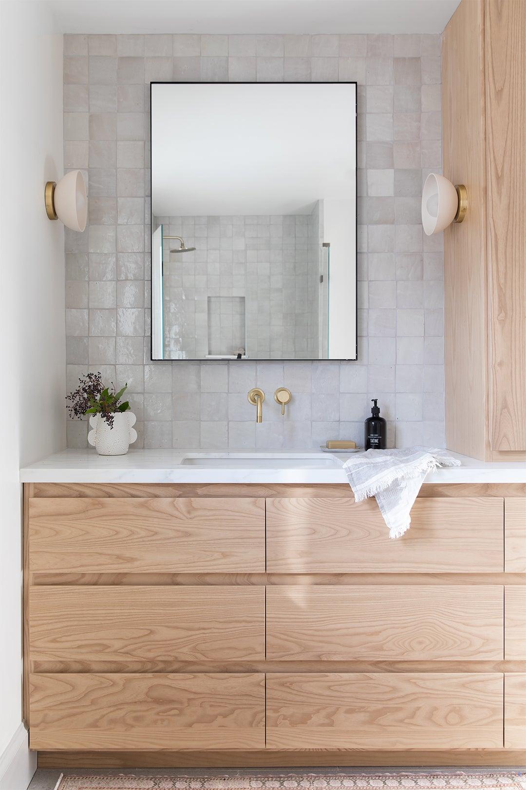 Bathroom with zellige tile and light oak cabinets