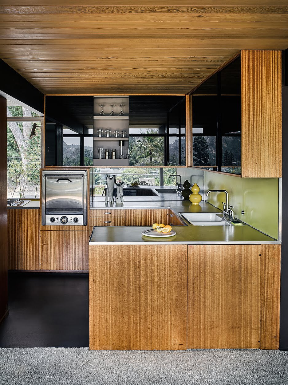 wood kithen wiht green counters