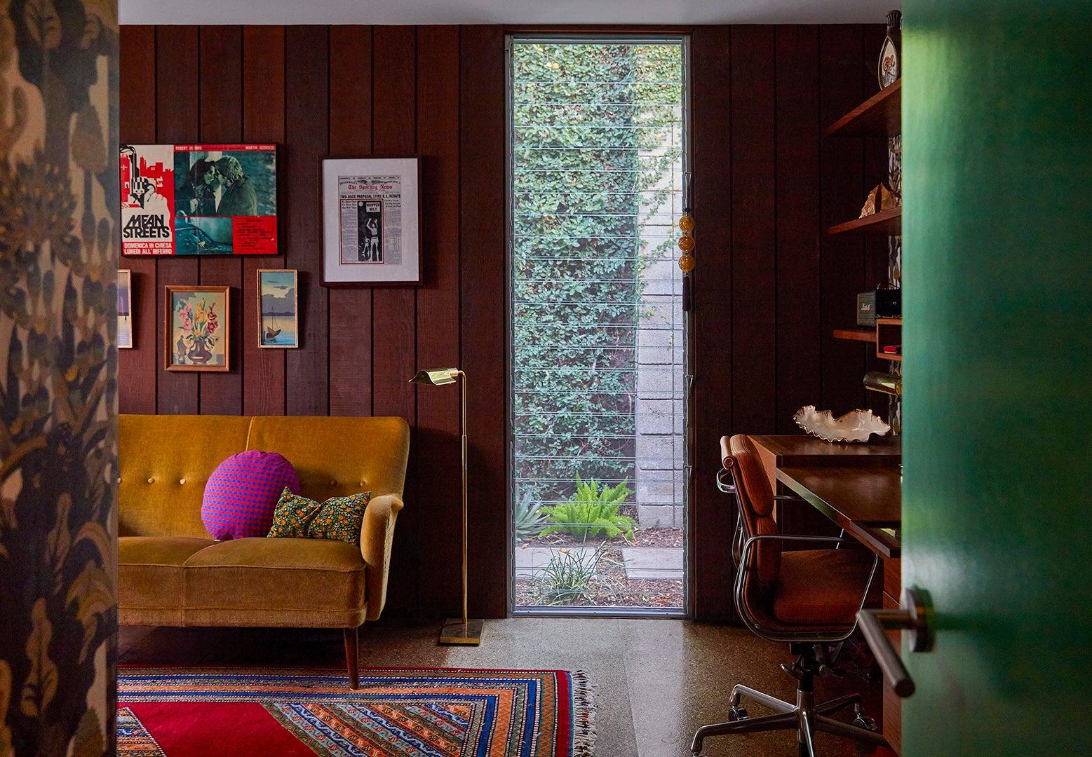 wood paneled room with yellow sofa