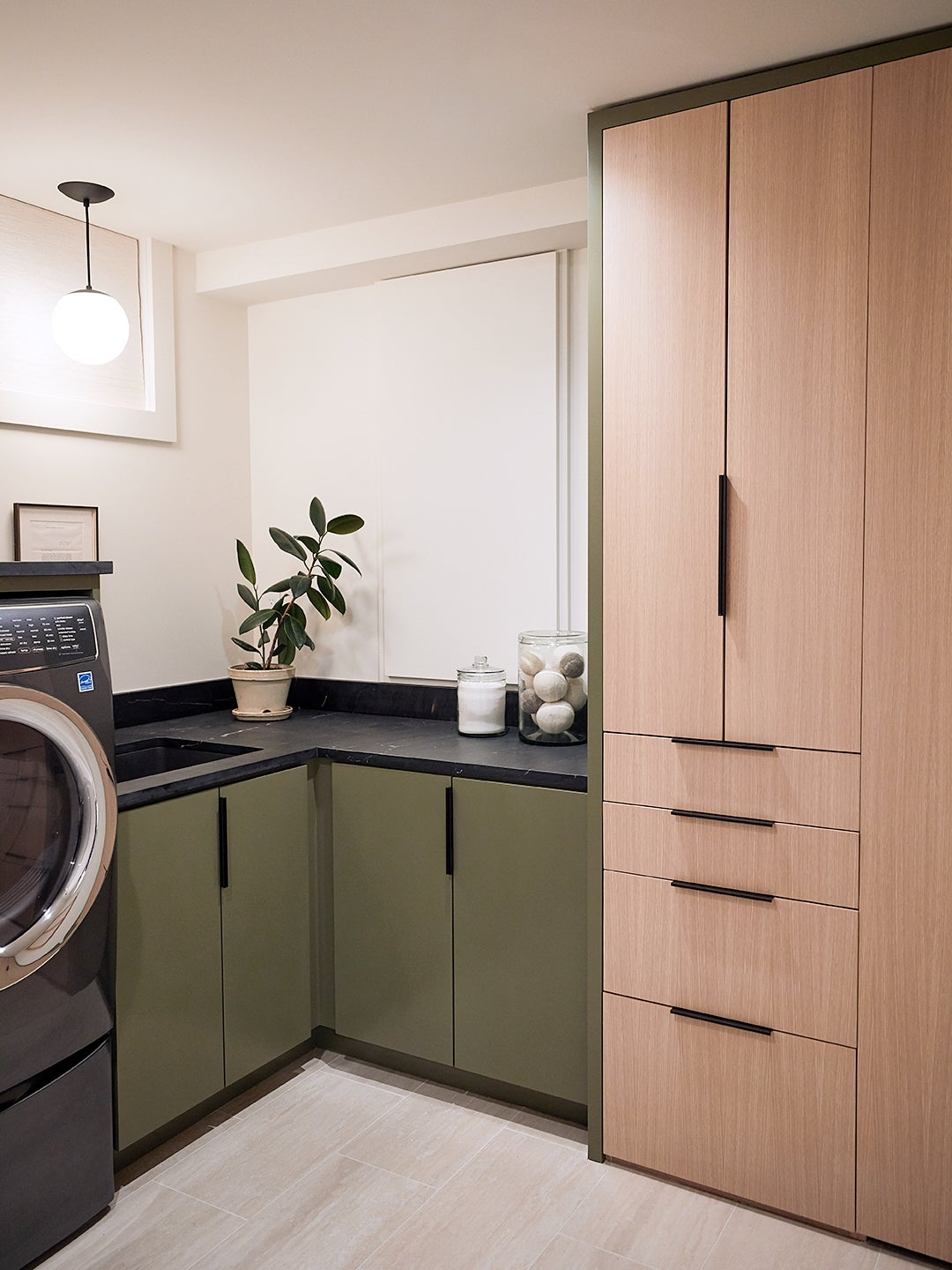 Renovated laundry room with cabinets
