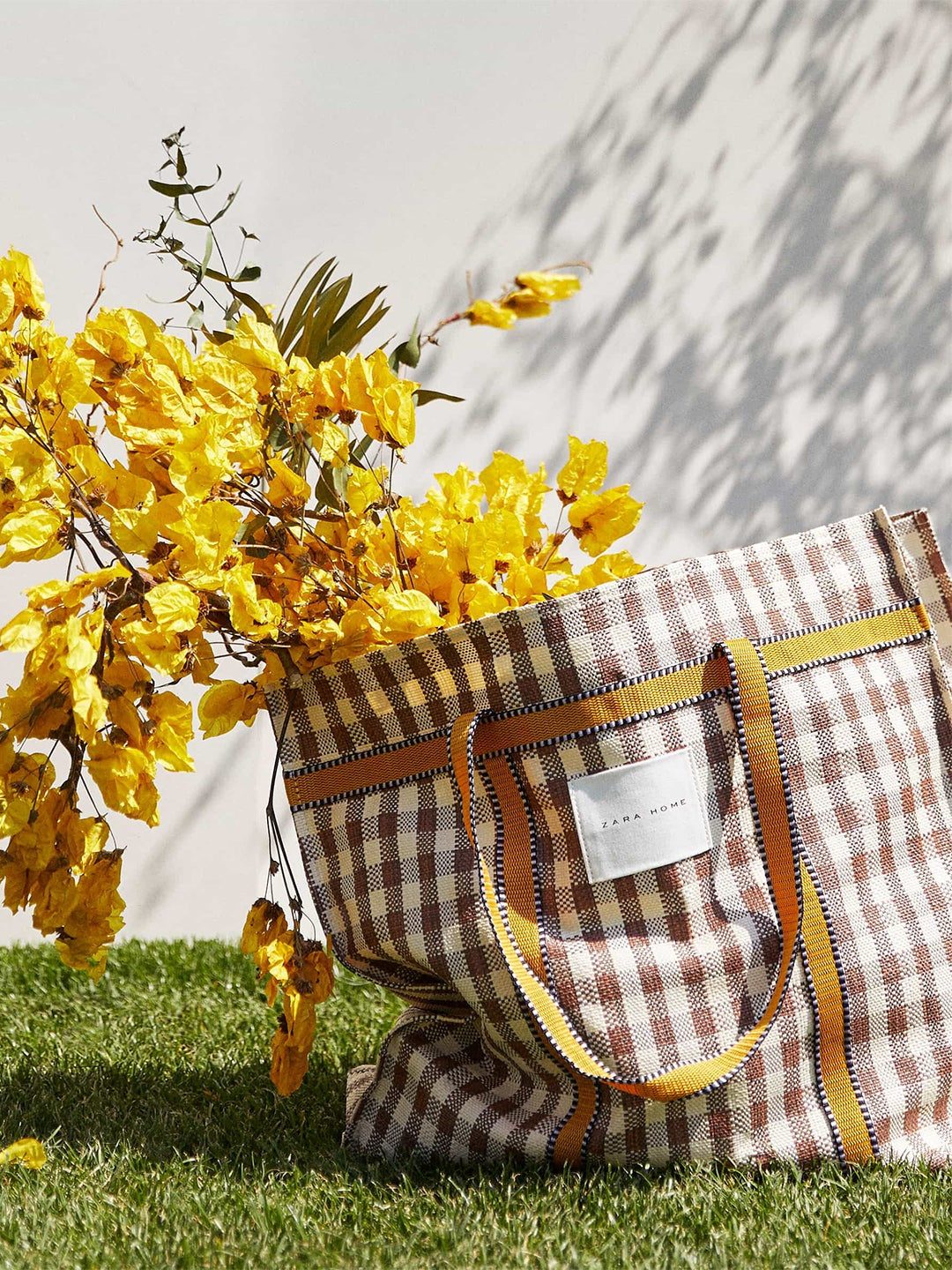 yellow flowers in a check bag