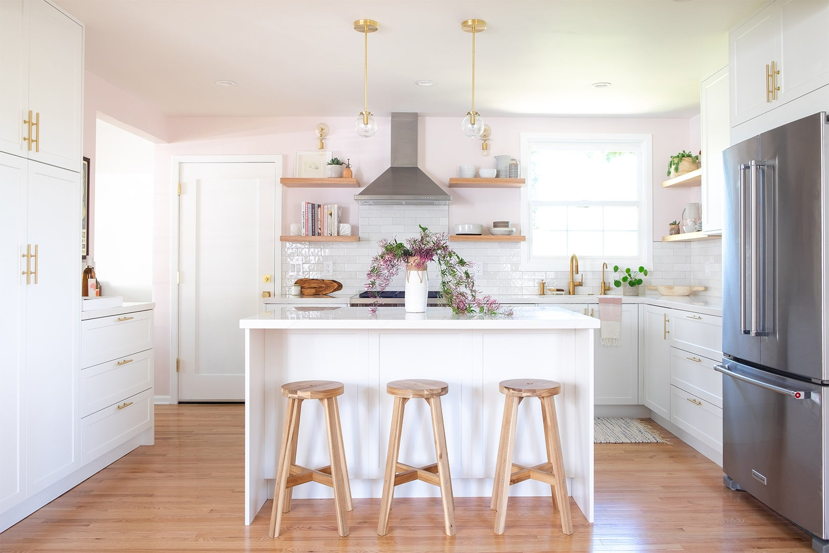 white island in a pink kitchen