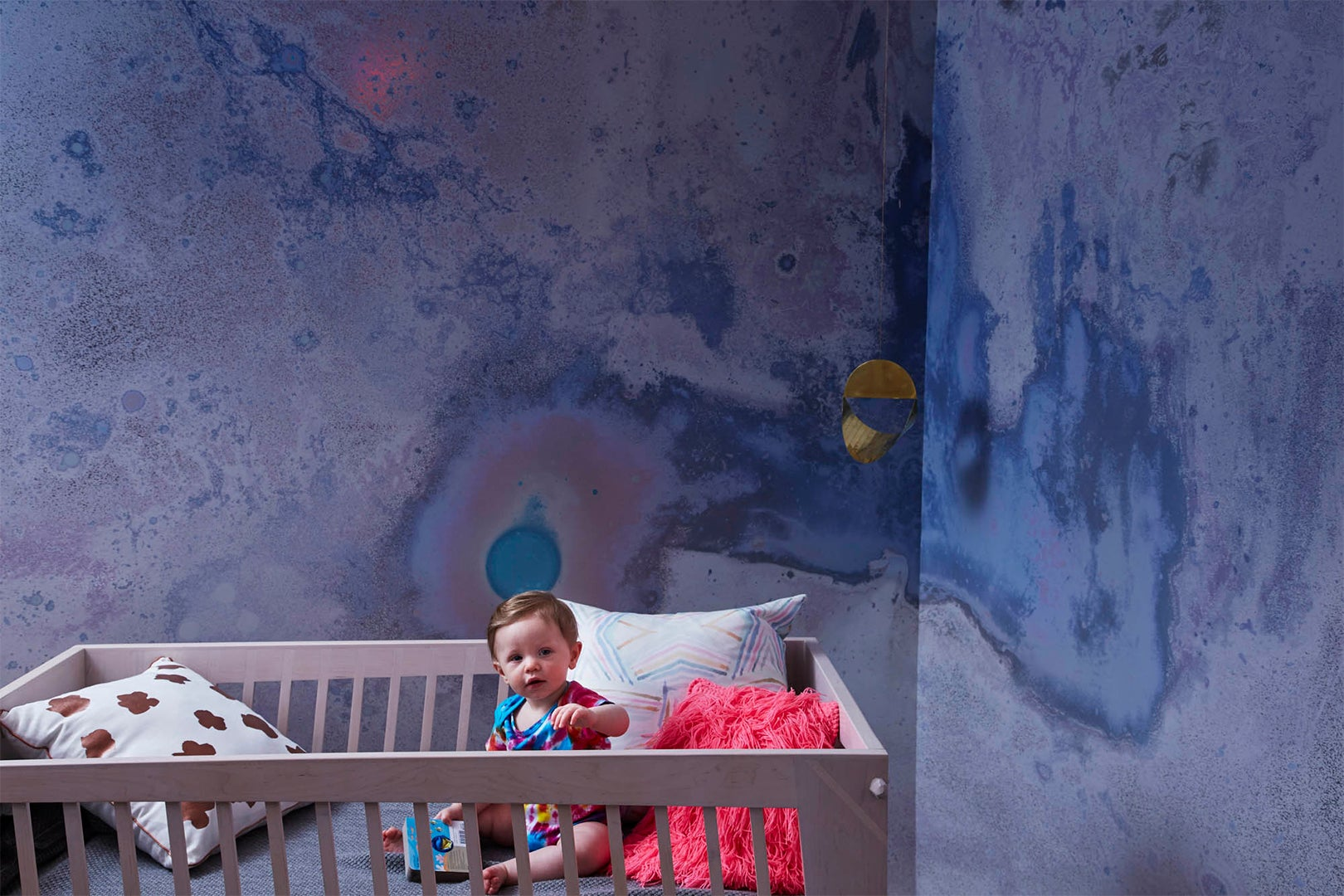 Nursery with iridescent wallpaper