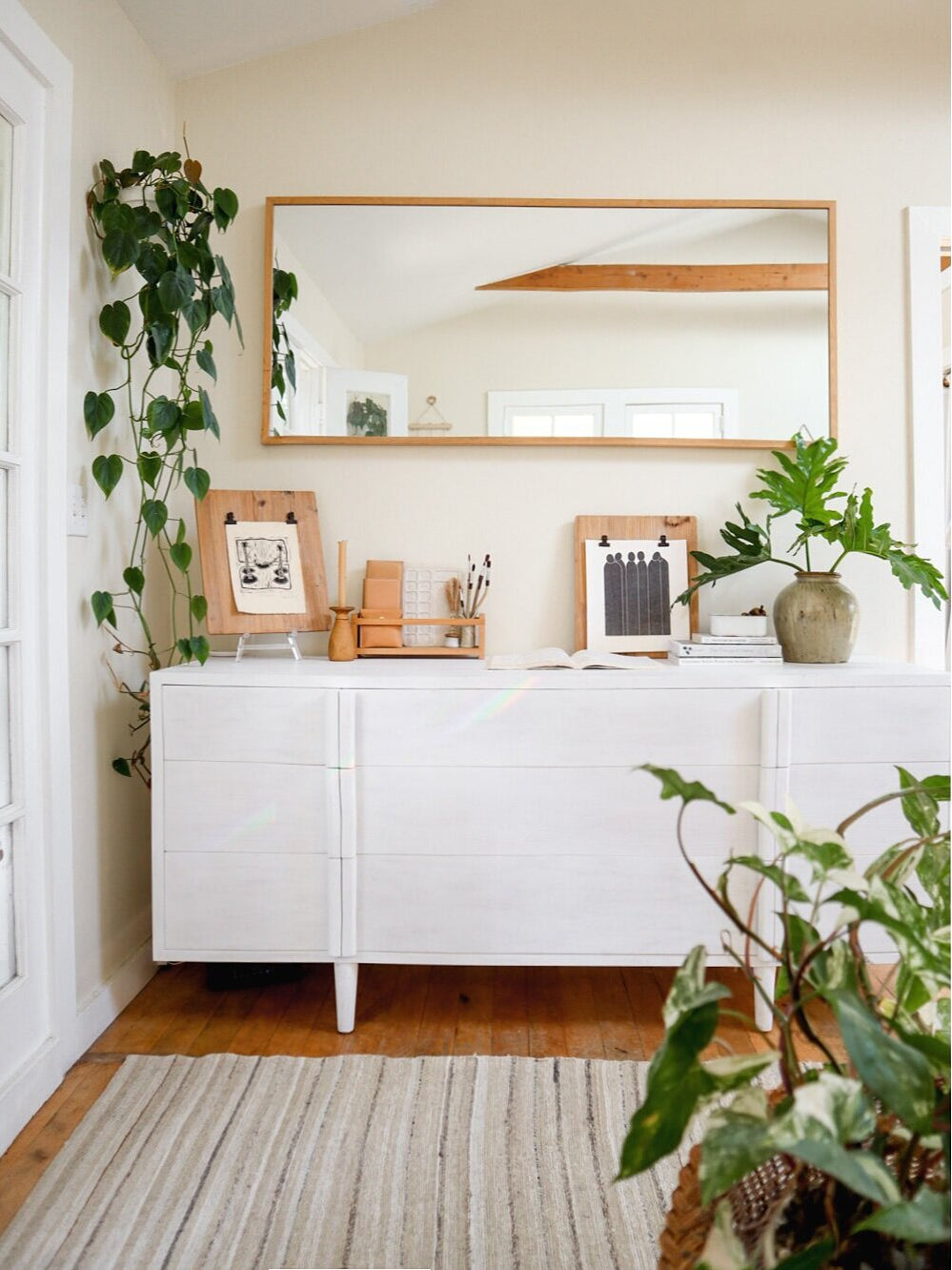 white credenza with photos on top