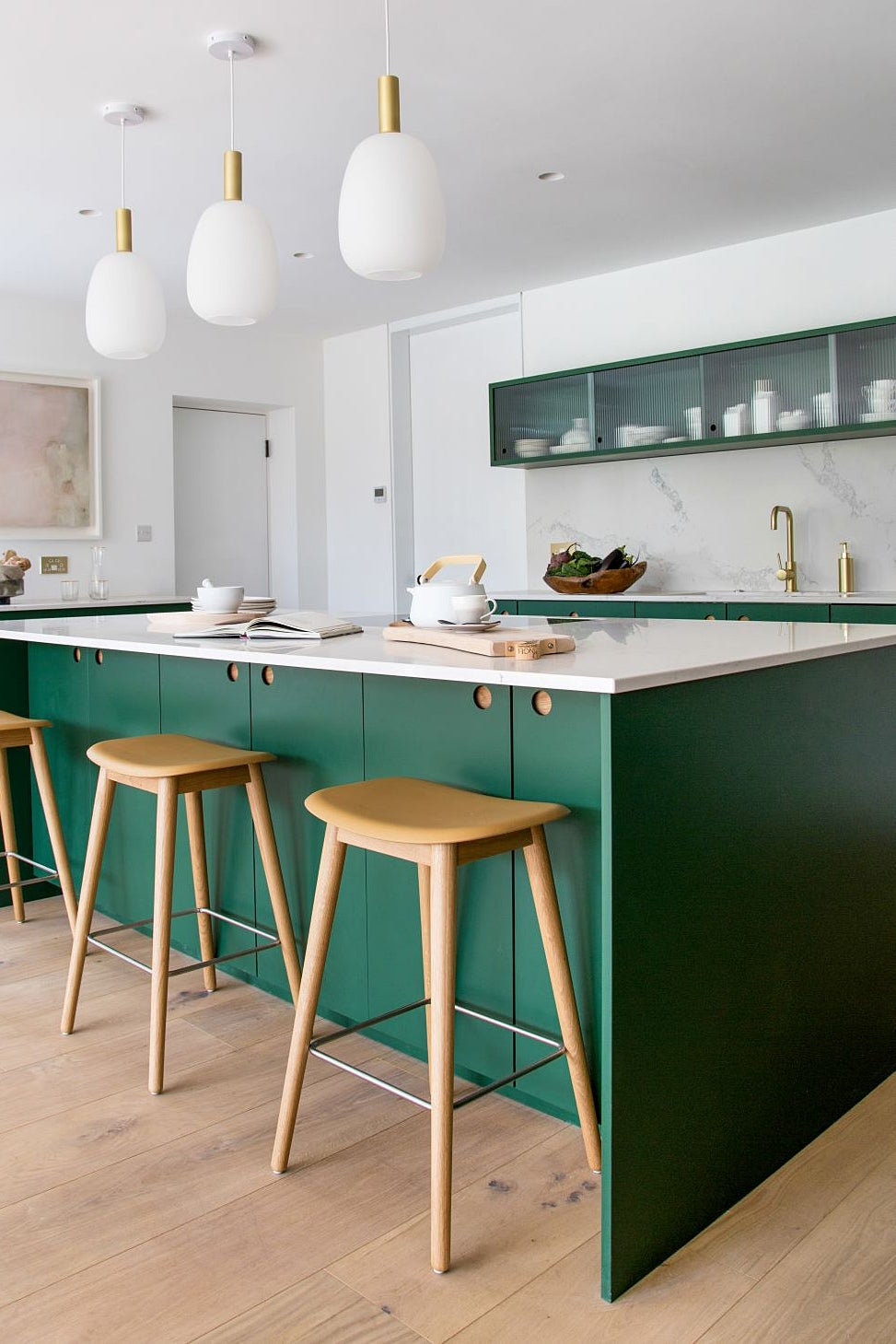 modern green kitchen with bar stools
