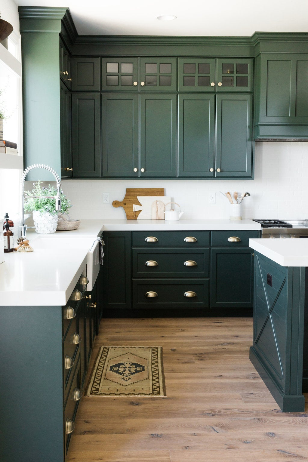 forest green kitchen cabinets marble counters