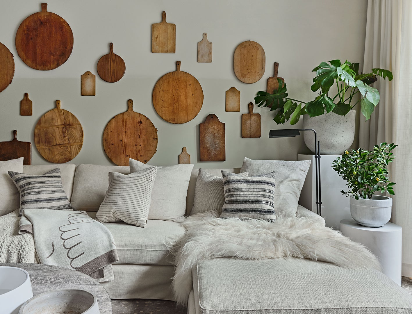 cutting board gallery wall above white sofa