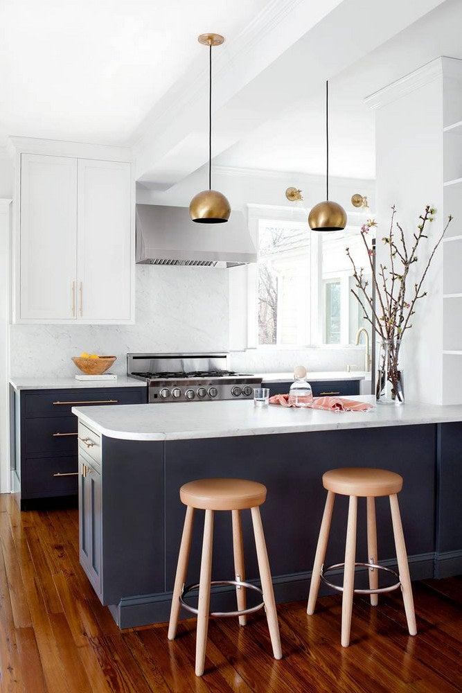 black white and brass kitchen