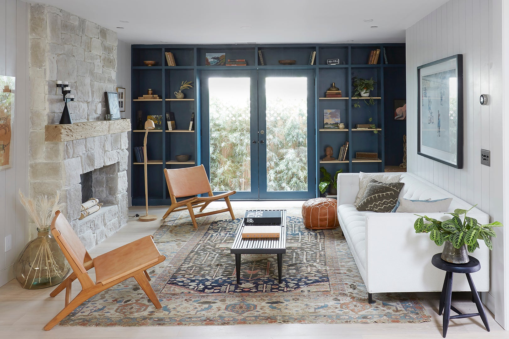 Living room with navy shelves
