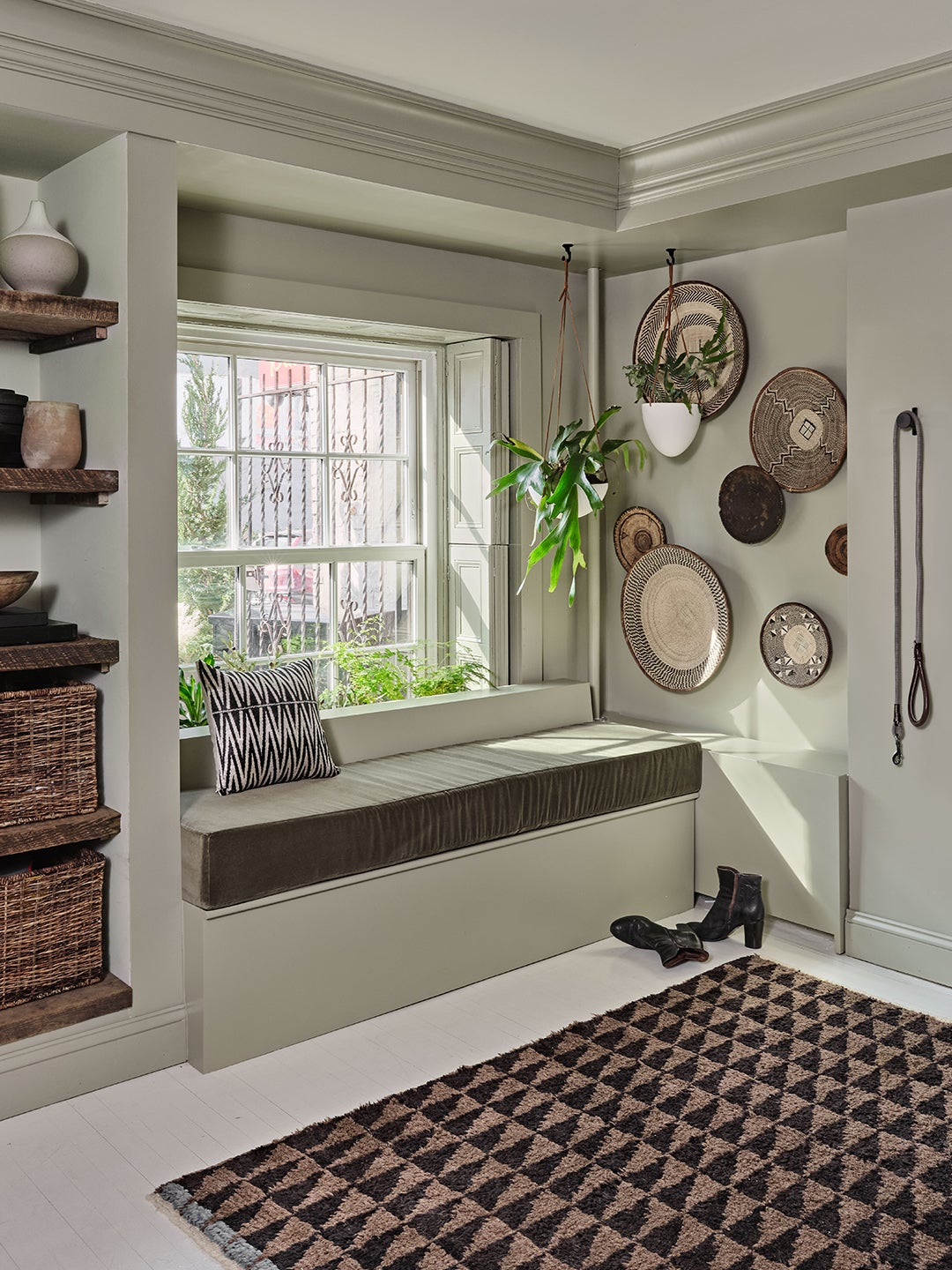 green entryway nook with hanging baskets