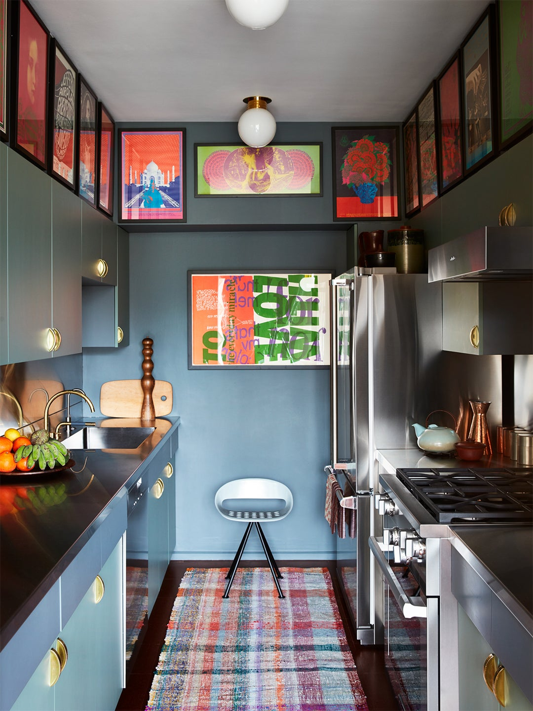 blue kitchen with artwork on walls