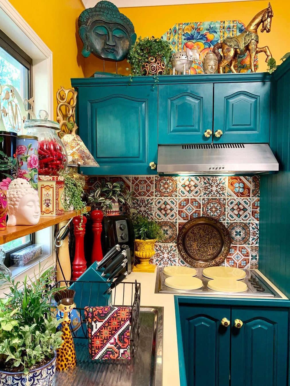 teal kitchen cabinets and colorful backdrop
