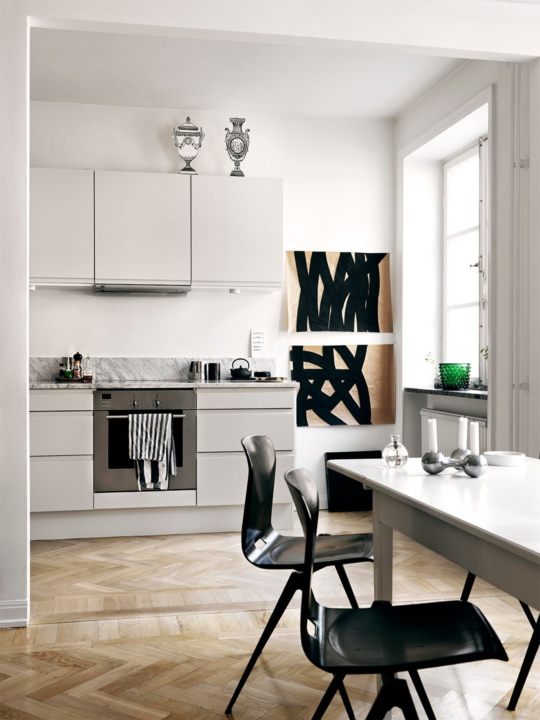 white kitchen with paper vases on top of cabinets