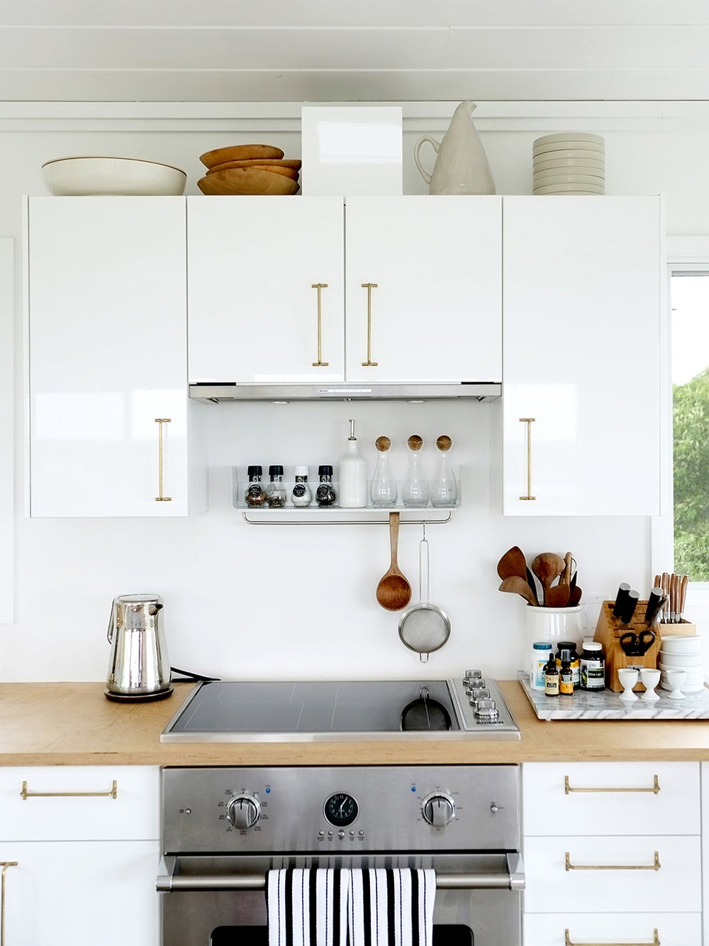 white kitchen butcher block counters vase collection