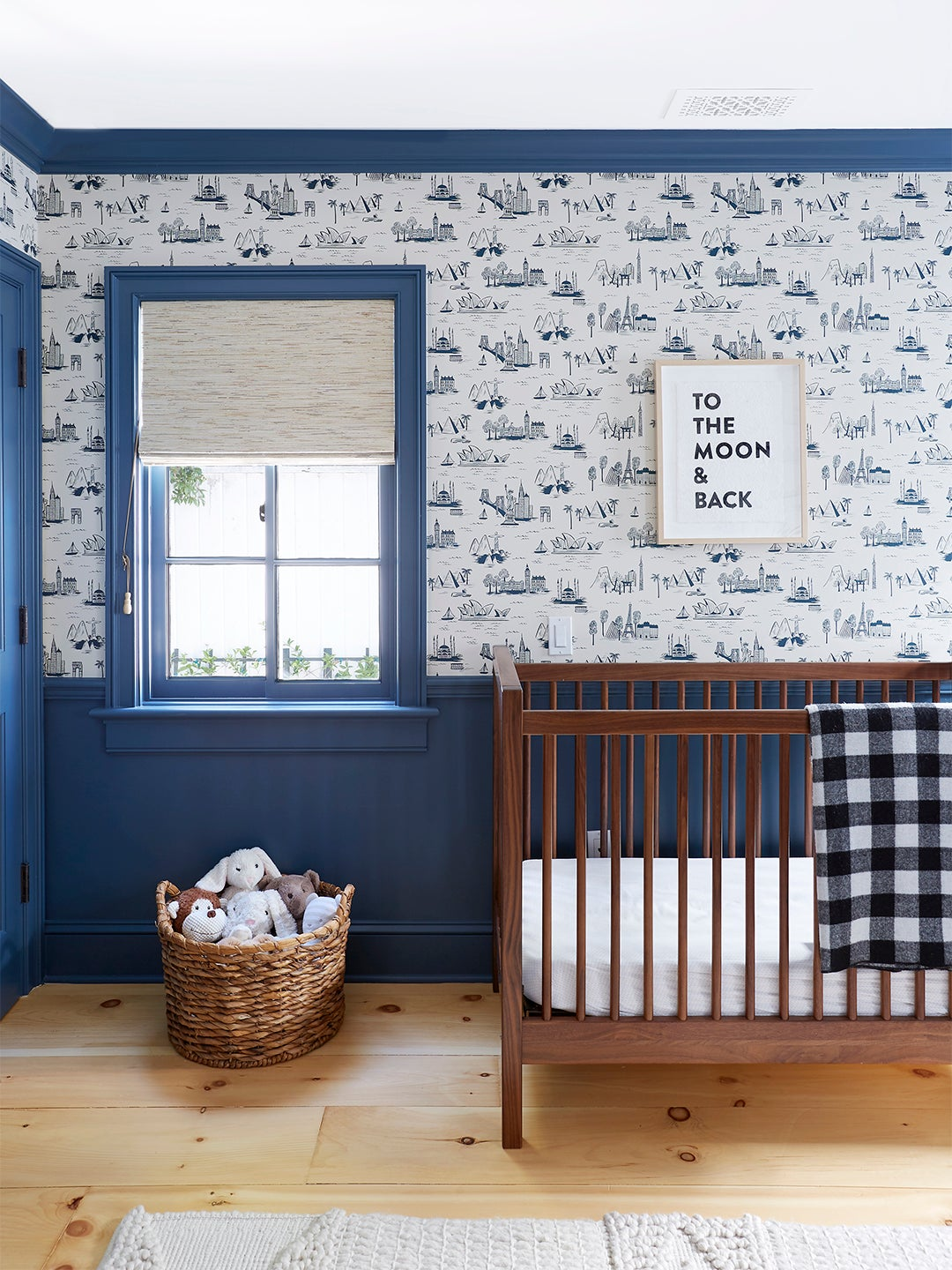 Nursery with blue and white wallpaper