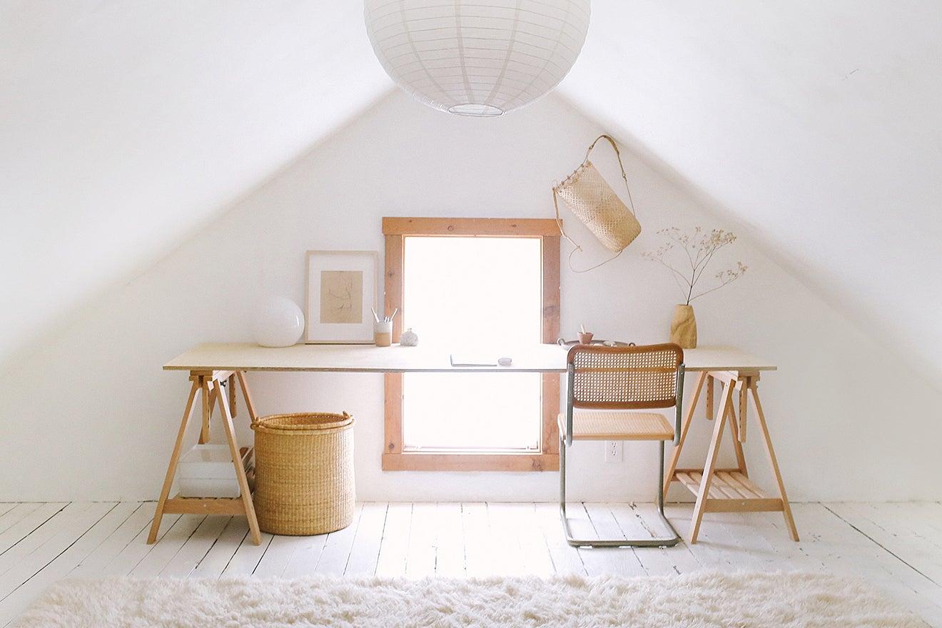 white desk space with lantern pendant