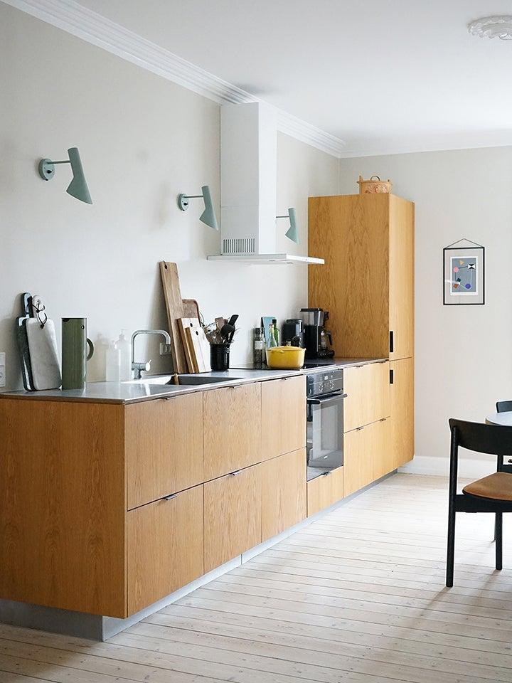 wood kitchen cabinets mint sconces
