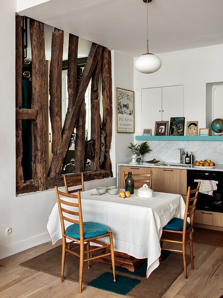 white tiny kitchen with turquoise shelf and dining space