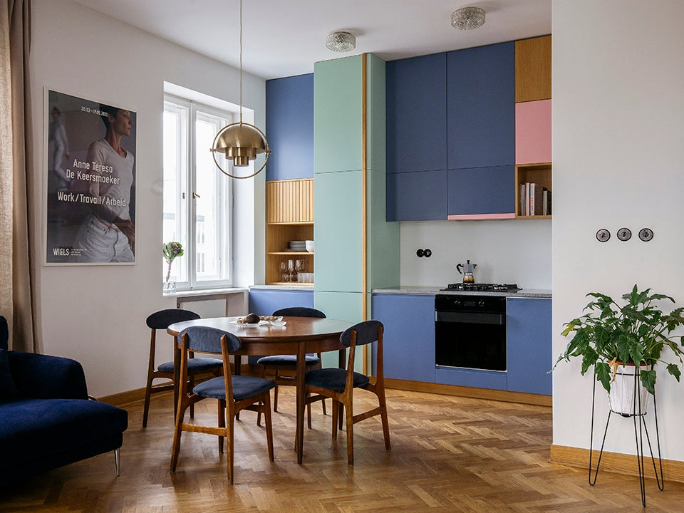color-blocked kitchen cabinets and dining table