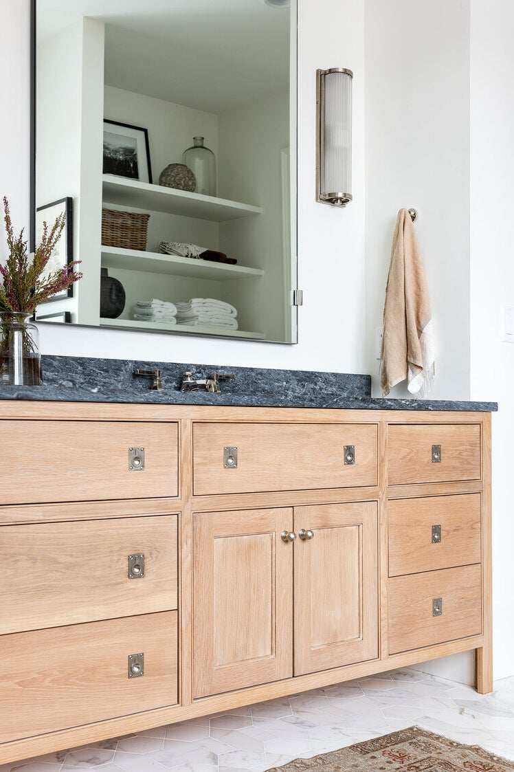 bathroom vanity with twin mirrors and tall legs