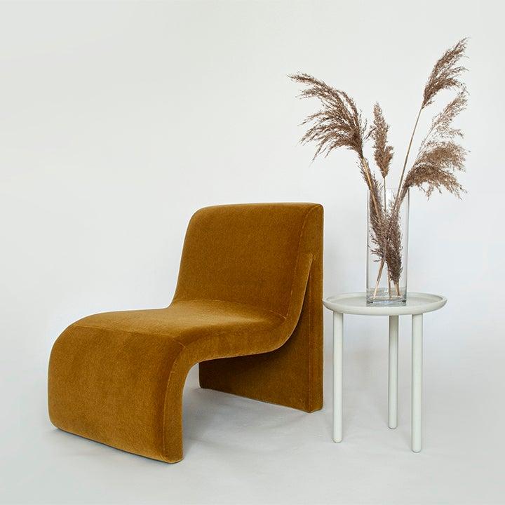 ochre curved armchair