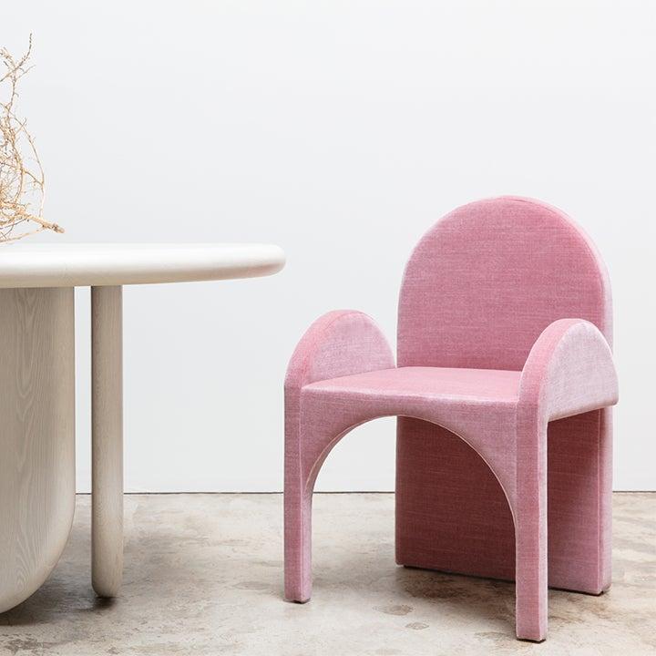 pink curvy armchair
