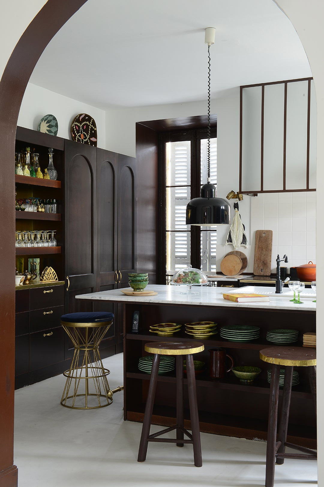 dark wood kitchen with lots of ceramic plates