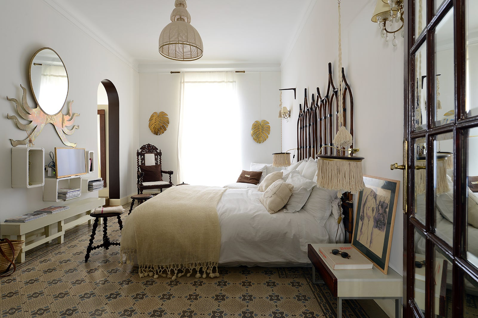 bedroom with tile floor and woven pendant light