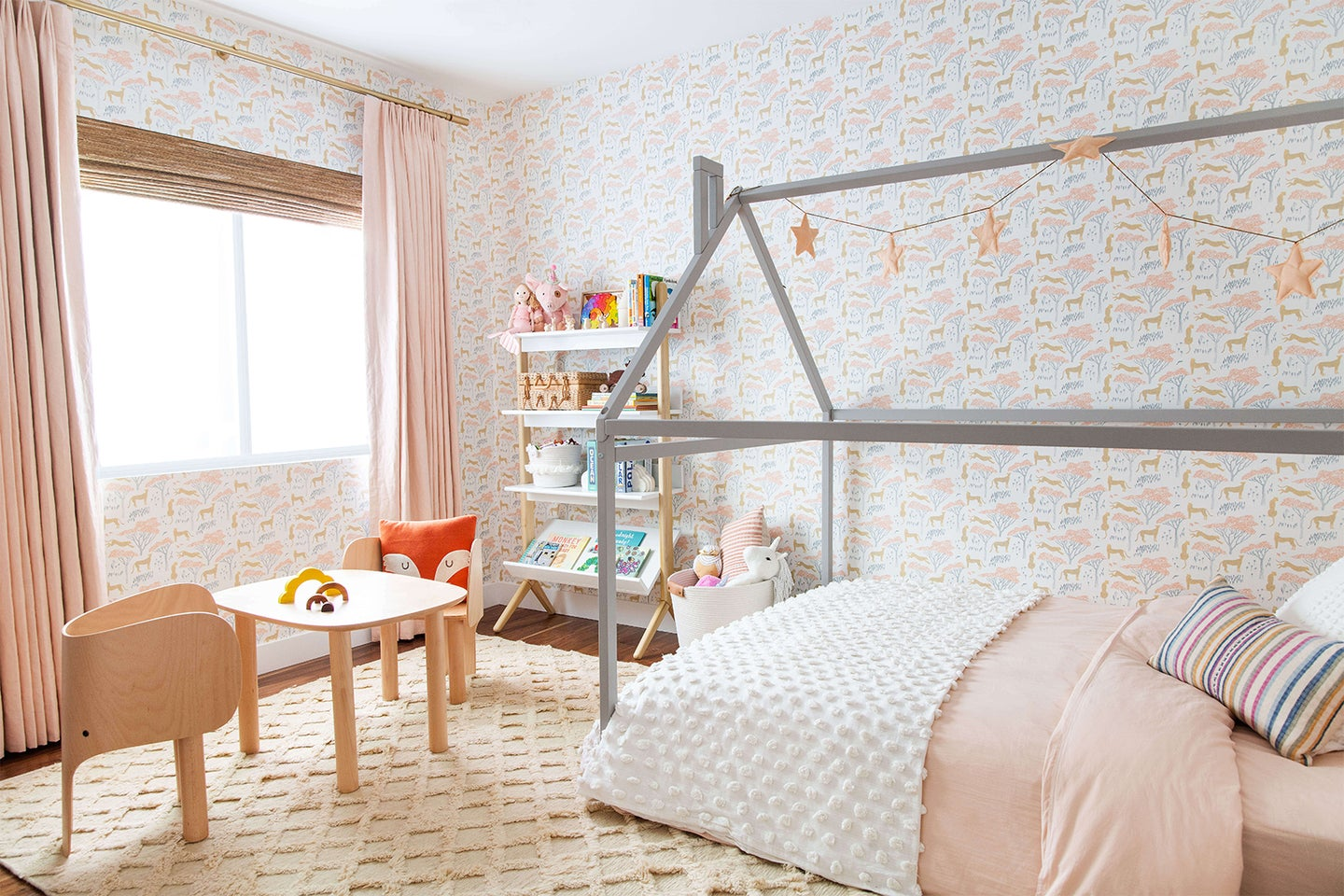 Kids room with house-shaped bed and Hygge & West wallpaper