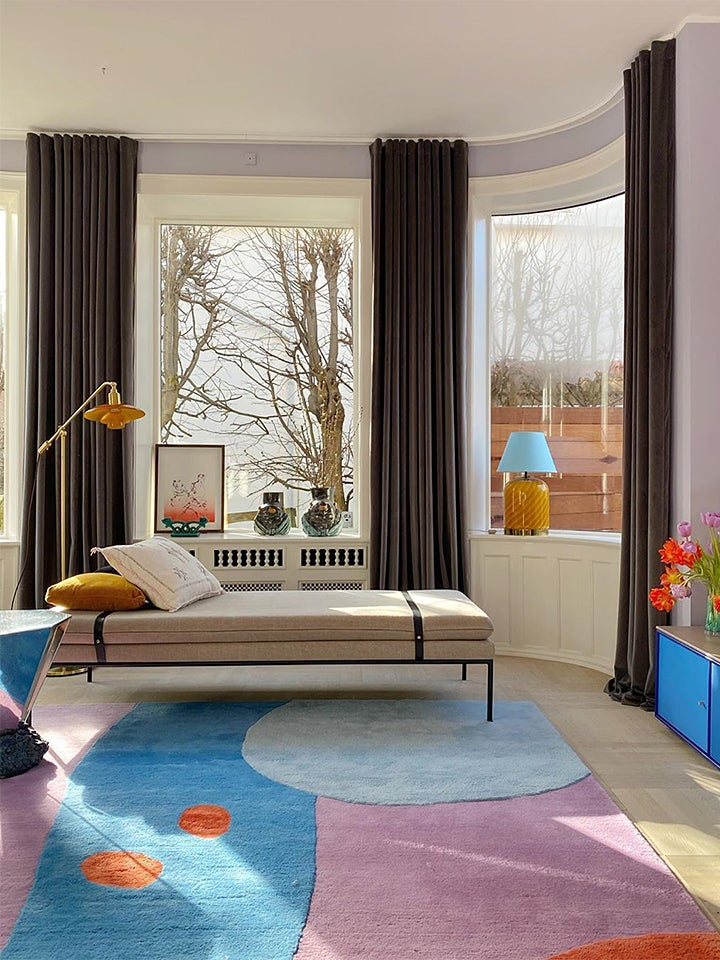 pastel colored living room with multicolored rug