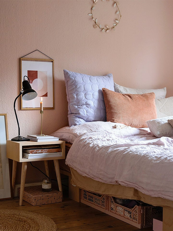 pink bedroom with pastel pillows