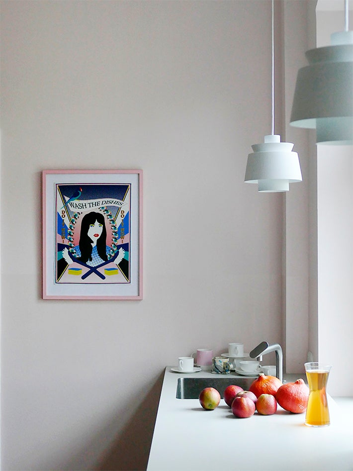 pale pink kitchen wall with blue pendant