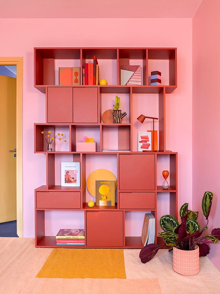 pink wall pink bookshelf
