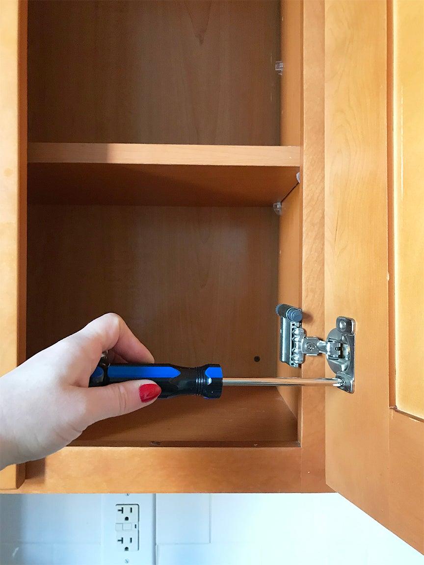 Unscrewing cabinet doors