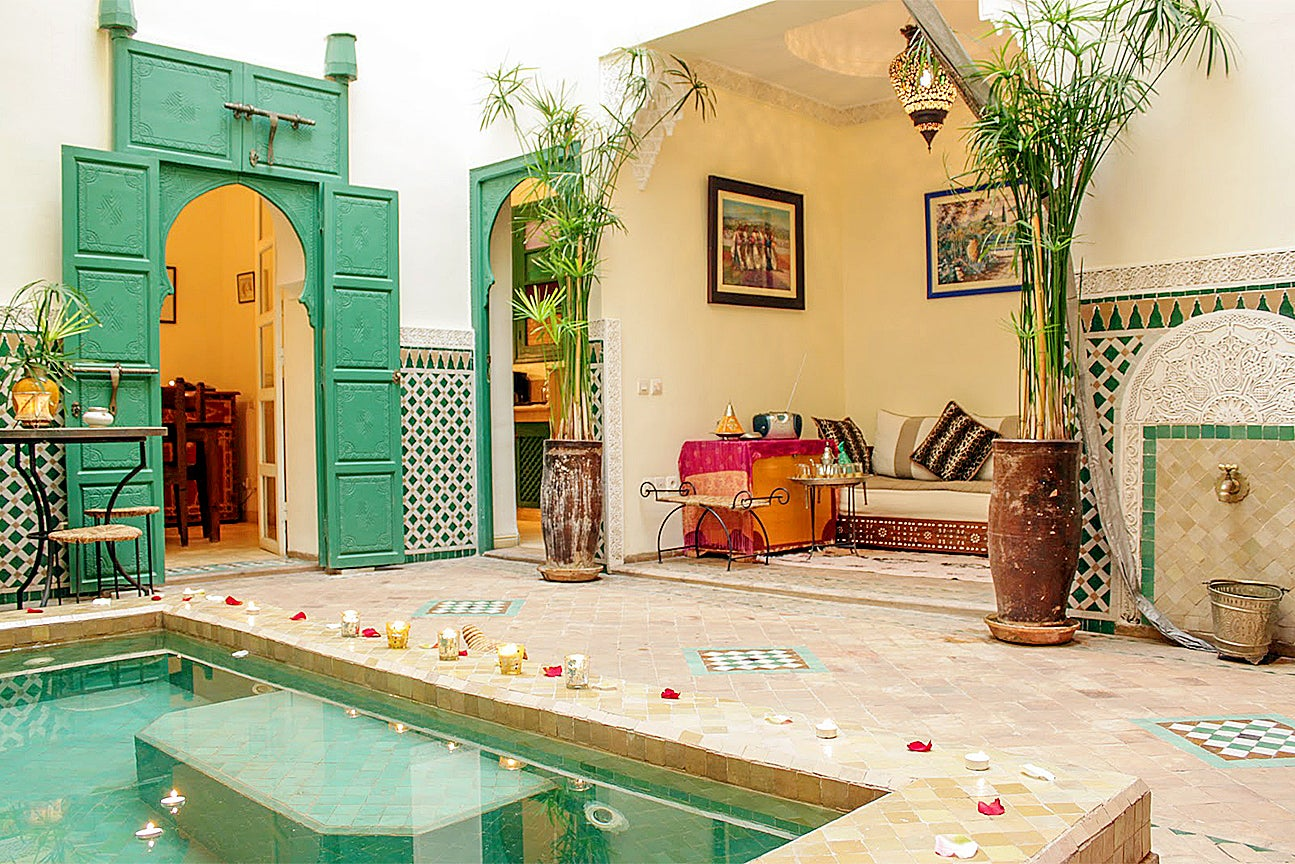 moroccan riad with seating nook and green doors