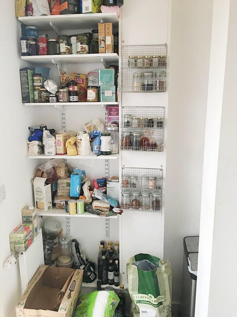 old white disorganized pantry